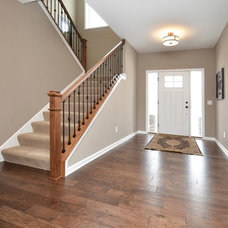Traditional Staircase by Regency Homes, Inc.