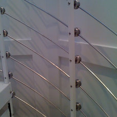 Modern Staircase by Mitchell Welding & Iron Works, Inc.