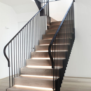 Inspiration for a modern wood u-shaped staircase in Sydney with wood risers.