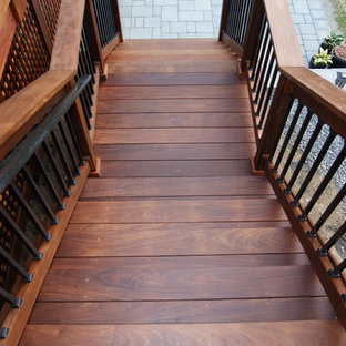 Inspiration for a mid-sized timeless wooden straight staircase remodel in New York with wooden risers