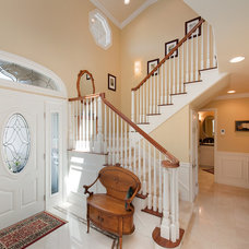 Traditional Staircase by Burgin Construction