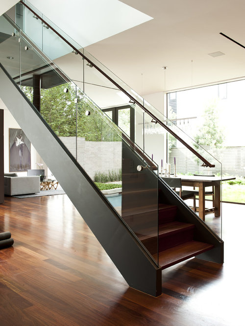 Inspiration For A Modern Wooden Glass Railing Staircase Remodel In Houston
