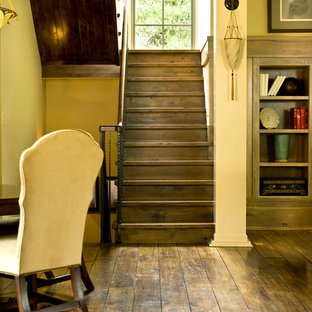 Inspiration for a timeless wooden u-shaped staircase remodel in Chicago with wooden risers