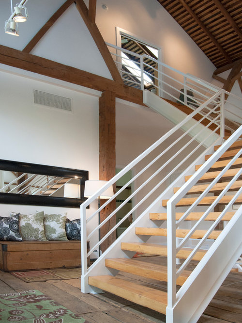 Example Of A Large Country Wooden U Shaped Open Staircase Design In  Cleveland