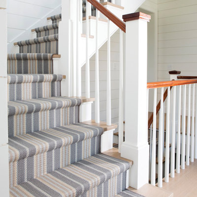 Example of a mid-sized beach style wooden l-shaped wood railing staircase design in Boston with painted risers