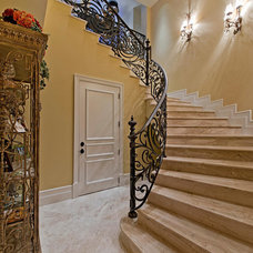Traditional Staircase by Jere Bradwell