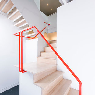 Staircase - industrial wooden l-shaped staircase idea in DC Metro with wooden risers