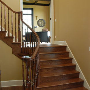 Inspiration for a timeless wooden floating staircase remodel in Grand Rapids with wooden risers