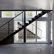 Modern Staircase by Klopf Architecture