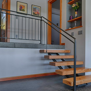 Small trendy wooden straight open staircase photo in Seattle