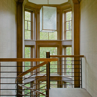 Mid-sized transitional wooden curved staircase photo in New York