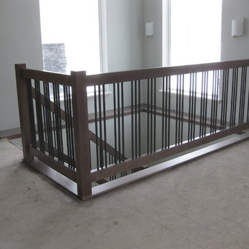 New Construction - Contemporary Maple Railings with Metal Spindles