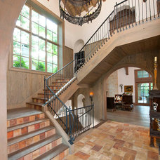 Mediterranean Staircase by Gage Homes Inc.