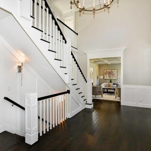 Large transitional wooden u-shaped staircase photo in Chicago with painted risers