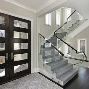 Staircase - mid-sized transitional concrete u-shaped glass railing staircase idea in Chicago with concrete risers