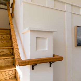 Inspiration for a mid-sized timeless wooden u-shaped wood railing staircase remodel in San Francisco with wooden risers