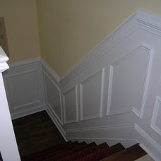 Traditional Staircase by Town Bank Builders Inc
