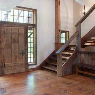 Photo of a medium sized rustic wood l-shaped staircase in Philadelphia with open risers.