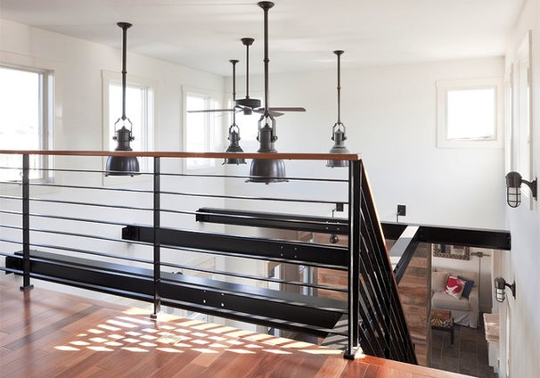 Industrial Dining Room by Richard Bubnowski Design LLC
