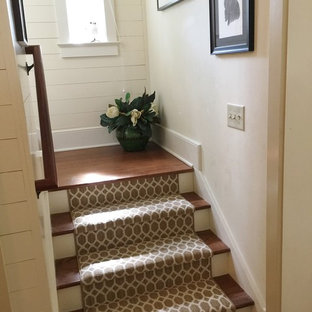 Example of a mid-sized classic wooden u-shaped staircase design in Charleston with painted risers