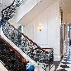 Traditional Staircase by Kindred Construction Ltd.