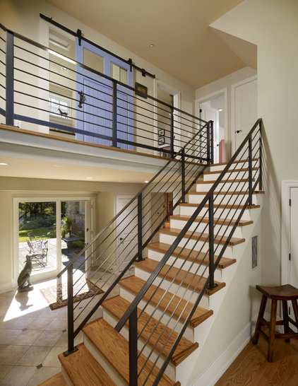Eclectic Staircase by Krieger + Associates Architects Inc