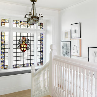 This is an example of a scandinavian wood u-shaped wood railing staircase in Seattle.