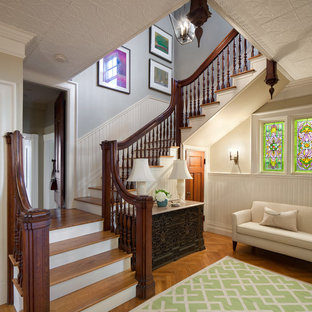 Photo of a victorian wood staircase in Providence with painted wood risers.