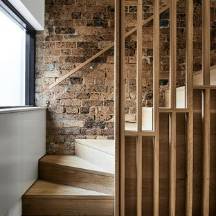 Scandinavian wood staircase in Sydney with wood risers and wood railing.