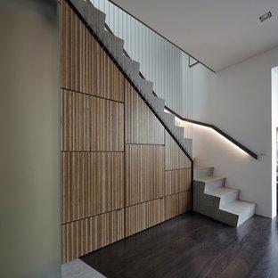 シドニーのコンクリートのコンテンポラリースタイルのおしゃれな階段 (コンクリートの蹴込み板) の写真