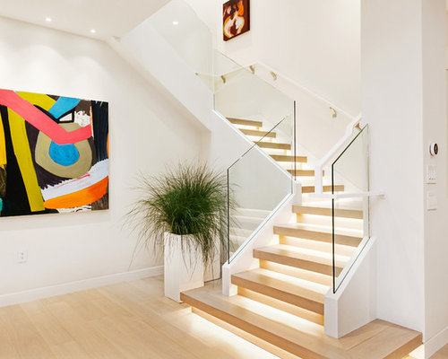example of a trendy wooden l shaped glass railing staircase design in san francisco - Staircase Design Ideas