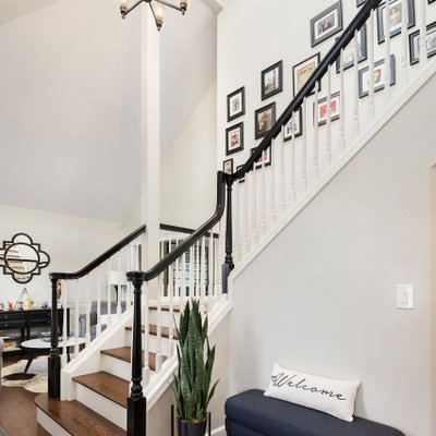 Inspiration for a large transitional wooden l-shaped wood railing staircase remodel in Seattle with wooden risers