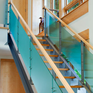 Inspiration for a contemporary wooden straight staircase remodel in Seattle with glass risers