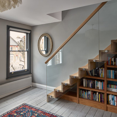 Staircase - contemporary wooden staircase idea in London with wooden risers