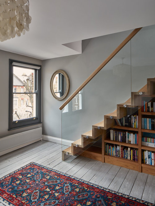 this is an example of a contemporary and modern wood staircase in london with wood risers - Stairs Design Ideas
