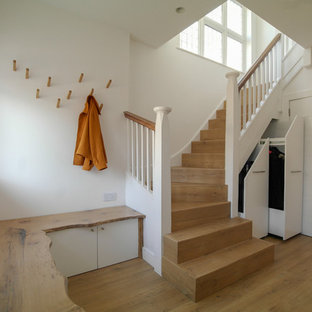 Photo of a traditional wood u-shaped wood railing staircase in London with wood risers.