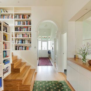Mid-sized elegant wooden u-shaped staircase photo in Melbourne with wooden risers