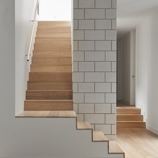 This is an example of a modern wood l-shaped staircase in Melbourne with wood risers.