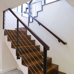 Minimalist wooden cable railing staircase photo in Portland with wooden risers