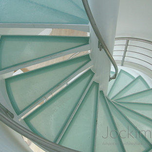 Inspiration for a contemporary glass spiral staircase remodel in New York with glass risers