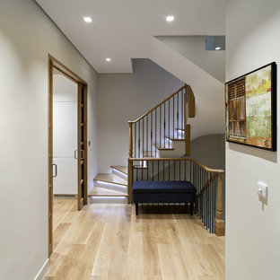 Design ideas for a classic wood staircase in London with painted wood risers.