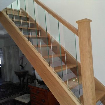 Oak staircase with glass spindles