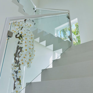 Inspiration for a large contemporary painted curved staircase remodel in Miami with painted risers