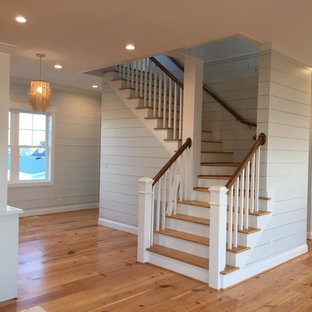 Staircase - coastal wooden l-shaped wood railing staircase idea in Other with wooden risers