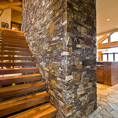 traditional staircase by Sticks and Stones Design Group Inc