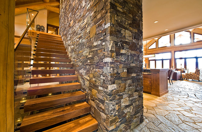 Rustic Staircase by Sticks and Stones Design Group Inc