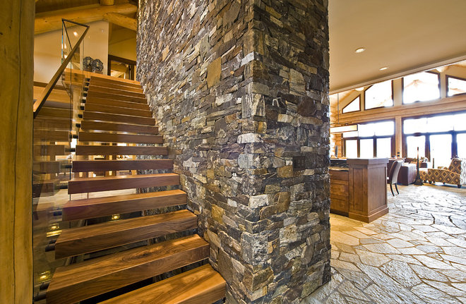 Rustic Staircase by Sticks and Stones Design Group inc.