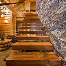 Eclectic Staircase by Sticks and Stones Design Group Inc