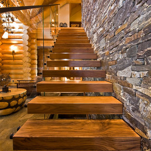 Inspiration for a rustic floating staircase remodel in Calgary