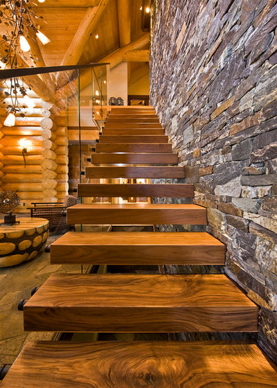 Rustic Staircase by Sticks + Stones Design Group inc.